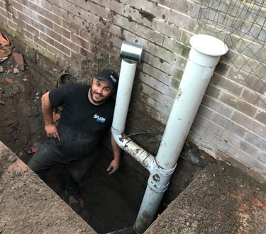 plumber working with pipes