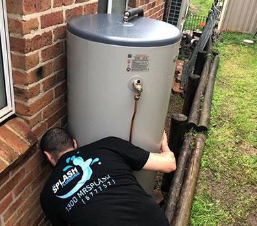 plumber installing